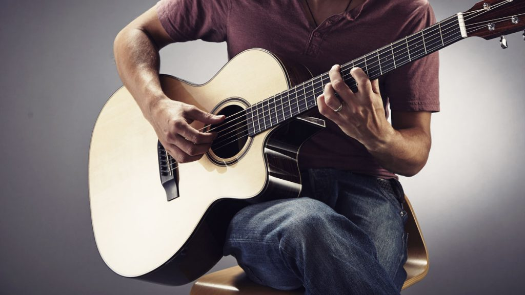 best dating photos for guys playing guitar
